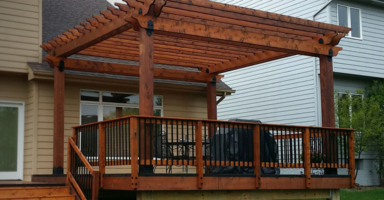 Relax in the shade with this cedar deck and pergola combo made with OZCO Wood Ties