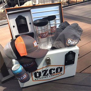 OZCO cooler with hats and t-shirts inside of it