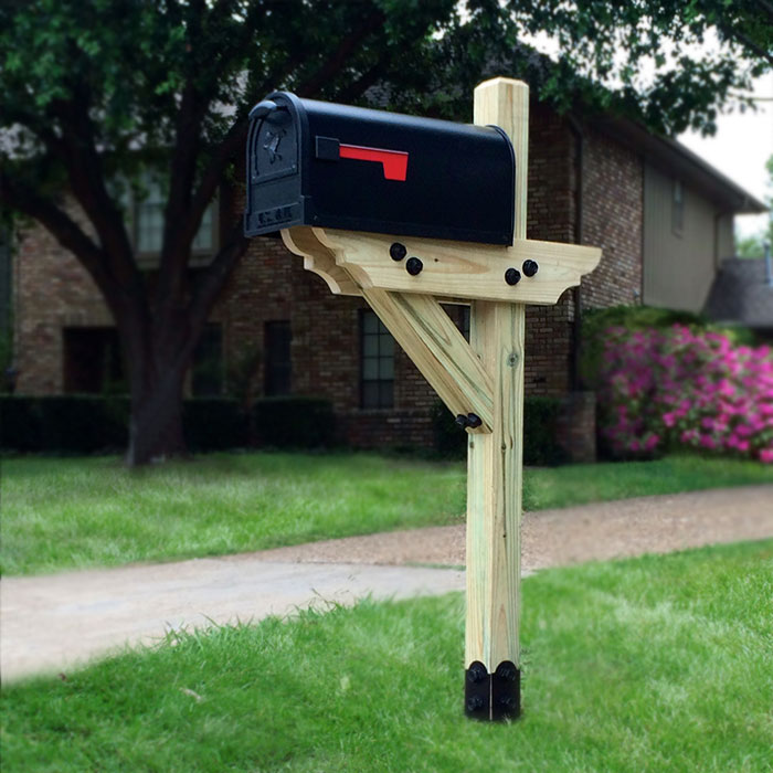 a mailbox installed on grass using the Ornamental Post Anchor Kit by OZ-Post