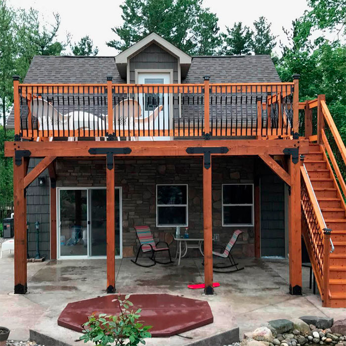 a wood deck with metal balusters and OZCO wood Ties
