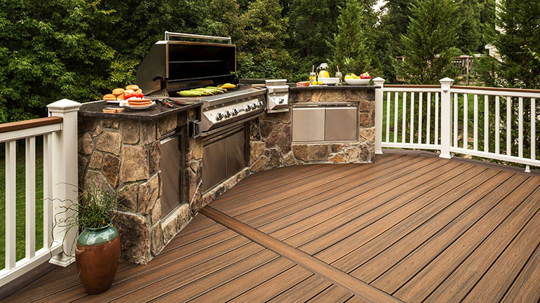 a built in grill on a composite deck with composite railing
