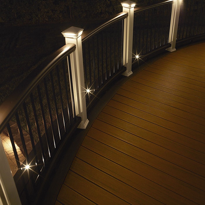 Trex Transcend rail in Vintage Lantern with Classic White railing with Trex Deck Lighting at night