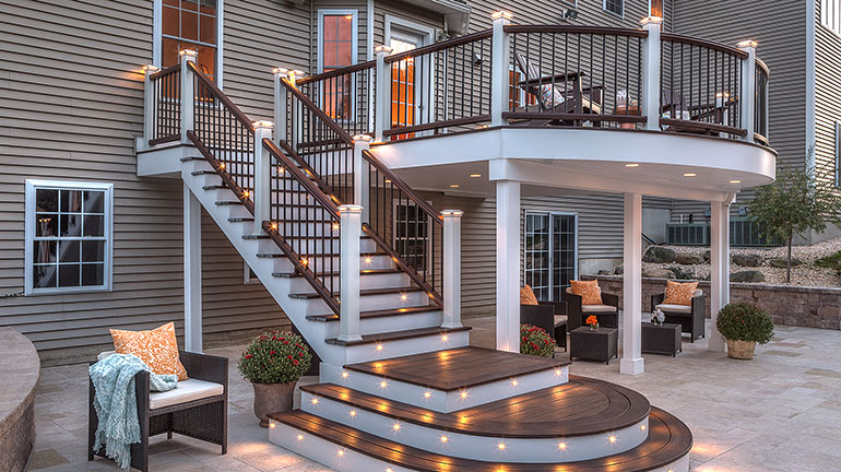 a Trex Deck complete with Railing, Decking, Lighting, and deck drainage