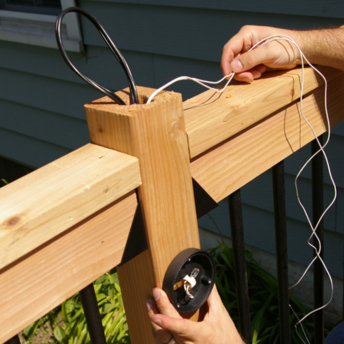 Running low voltage wire up a deck post and creatign a loop at the top