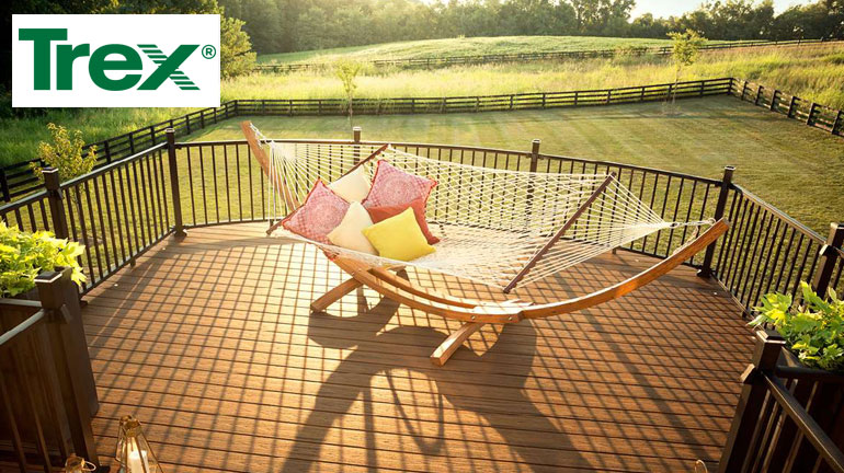 Relaxing Hammack on Trex Transcend Decking in Havana Gold with Trex Signature Railing