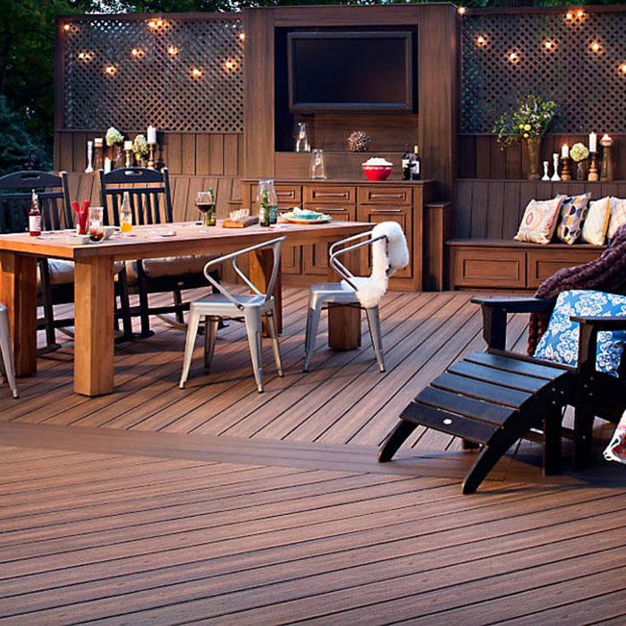 Make your deck a backyard destination with the stunning look of Trex Decking in Spiced Rum and Lava Rock.