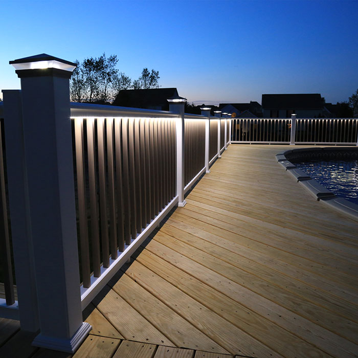 LMT Mercer Under Rail LED Strip Light on wooden deck around pool