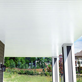 a deck with UpSide Deck Ceiling in white complete with ceiling fans for cooling