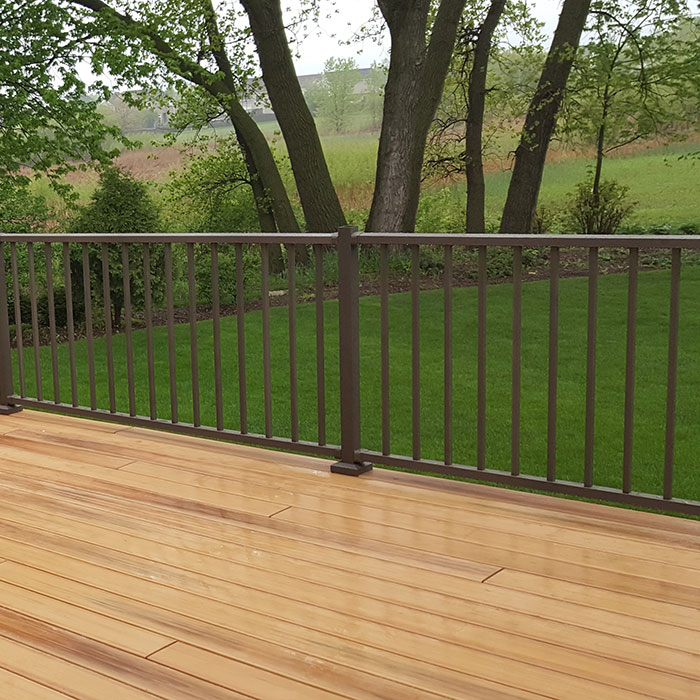 Cedar Deck with Westbury Aluminum Railing and Trees in the distance
