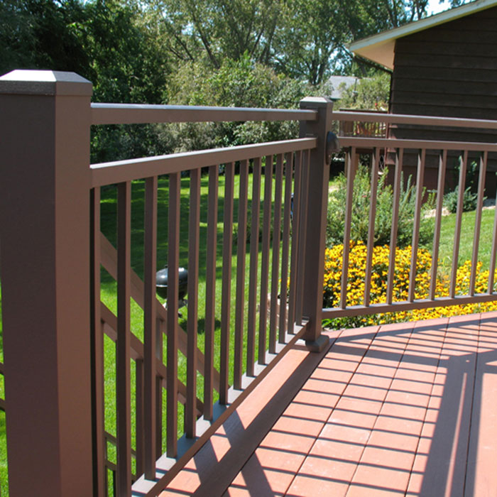 Westbury Riviera Aluminum Railing in Bronze Fine Texture with flower garden in the background