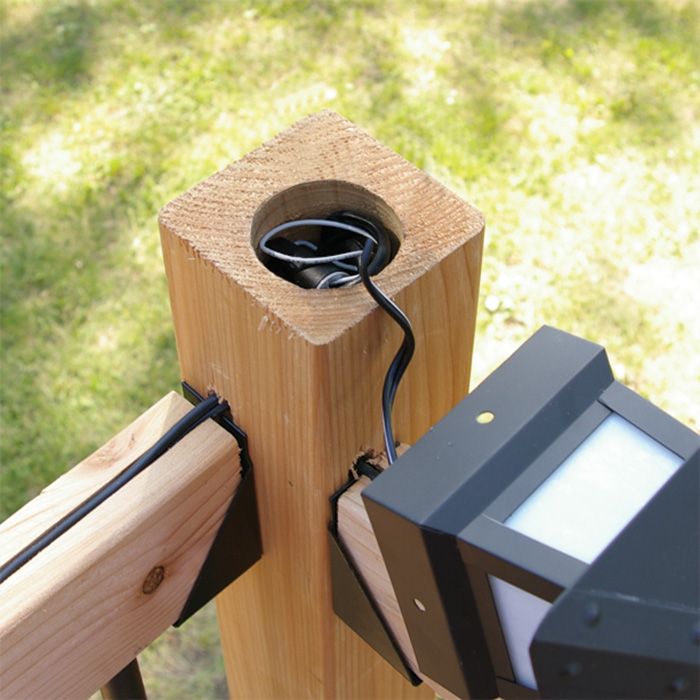 tuck the wires into the post for post cap installation