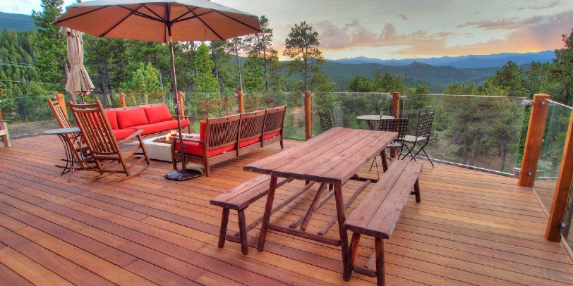 Glass railing systems can create a clear, strong barrier on your deck perimeter for a beautiful backyard view!