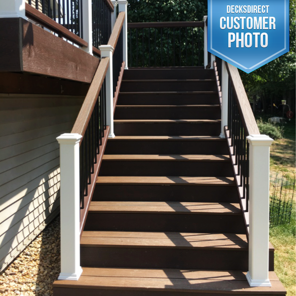 Trex Transcend Composite Stair Railing System With Rails In Vintage  Lantern, Posts In White, And Round Aluminum Balusters In Black.