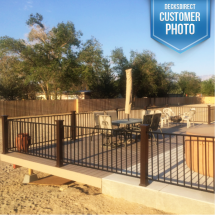 Deckorators CXT Composite Posts in Dark Walnut with Metal Railing Infill.