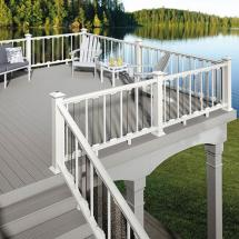 Deckorators CXT Colonial Railing in White with alternating Estate Aluminum and Scenic Frontier Glass Balusters. Also features Deckorators Solar Band Lights in White.