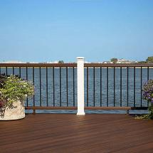 Trex Transcend Composite Level Railing System with Individual Top and Bottom Rail. Features an LED Flat Post Cap Light and Transcend Adjustable Foot Blocks with Black Baluster Infill.