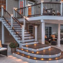 Trex Transcend Composite Stair Railing System with Individual Top Rail and Individal Bottom Rail. Features LED Flat Post Cap Light and Transcend Adjustable Foot Blocks.