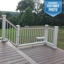 Trex Transcend Composite Level Railing System with Individual Top and Bottom Rail. Features an LED Flat Post Cap Light and Transcend Adjustable Foot Blocks with White Aluminum Baluster Infill.