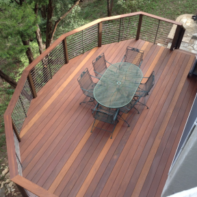 Feeney CableRail standard assemblies installed with custom wood railing.