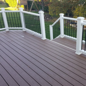 Trex Transcend Composite Railing System in Fire Pit with Round Aluminum Balusters.