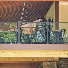 This photo features a Pure View Glass Railing System with Full Glass Panels housed in Aluminum Pure View Full Glass Panel Rails.