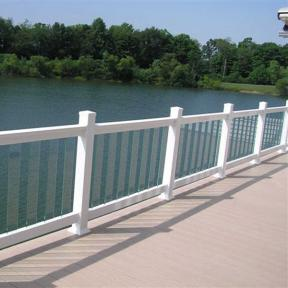 This photo shows a Fortress Pure View Glass Railing System in White. It features Pure View Glass Balusters by Fortress