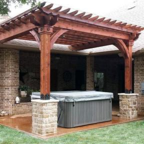 Hot Tub Pergola featuring the Post Base Kit, OD Star, and Rafter Clips by OZCO Ornamental Wood Ties