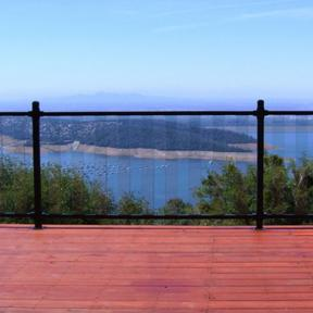Featured is a Pure View Glass Railing System in Black with Pure View Glass Balusters in a FE13 Pure View Glass Rail.