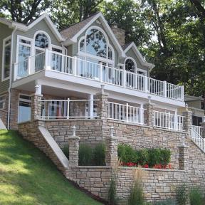 Featured here is a Pure View Glass Railing System in White with Pure View Glass Balusters.