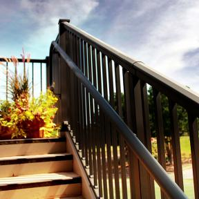 Afco Pro Aluminum Railing in textured black with stair handrail