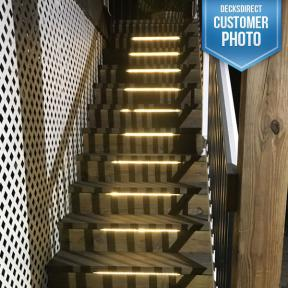The Odyssey LED Strip Light by Aurora Deck Lighting installed in deck stairs