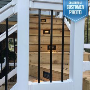 Aurora Pyxis Recessed Louvered LED Riser Light in bronze on cedar steps