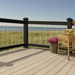Deckorators Aluminum Deck Railing in Black with Deckorators Cap Rail Kits and Glass Balusters. Also features Deckorators Pyramid Post Caps in Black.