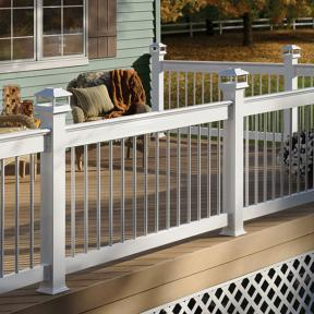Deckorators Aluminum Deck Railing in White with Deckorators Cap Rail Kits and Round Aluminum Balusters. Also features Deckorators Solar Post Caps Lights in White.