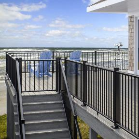 Deckorators ALX Classic Railing in Black with Deck Gate and Vault Dusk decking