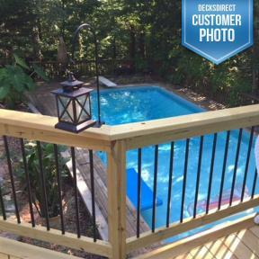 Poolside railings featuring Deckorators Classic Roudn Aluminum BalustersPoolside railings featuring Deckorators Classic Round Aluminum Balusters
