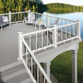 Deckorators CXT Colonial Railing in White with Deckorators Glass Balusters and White Estate Square Balusters. Also features Deckorators Solar Band Light in White.