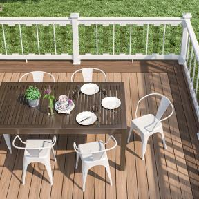 Stain and fade resistant, Deckorators Vault decking in Hickory completes an outdoor dining room.