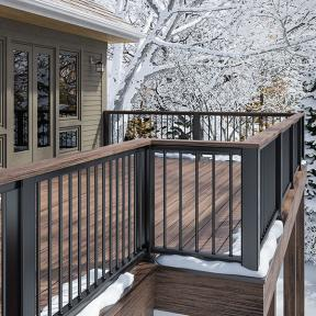 Tie your decking and railing together with a gorgeous drink rail made with Deckorators Vista decking in Ironwood.