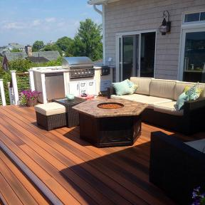 Tie separate pieces of your outdoor space together with multi-tonal DuraLife Siesta decking, shown in Brazilian Cherry.