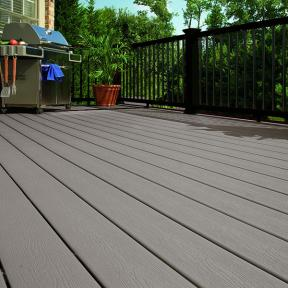 DuraLife Siesta Grooved Edge Deck Boards in a calm Coastal Grey lets your classic black railing take center stage.