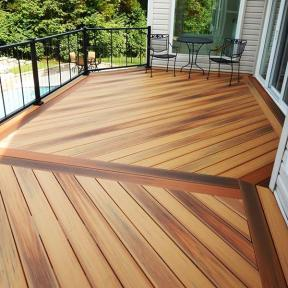 Design a unique decking layout for a space guests will notice with DuraLife Siesta Deck Boards in Golden Teak, Brazilian Cherry, and Mahogany.
