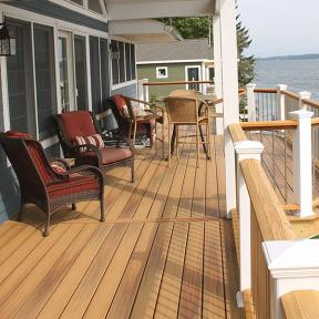 Keep the sun shining year round with stain and fade-resistant DuraLife Siesta Deck Boards, shown in Golden Teak.