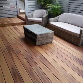 The smooth, unblemished surface of DuraLife Siesta Grooved Edge Deck Boards, in Golden Teak, invites barefoot relaxation.