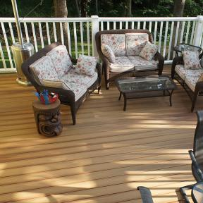 Help your white deck railing pop with the neutral look of DuraLife Siesta decking shown in Golden Teak.