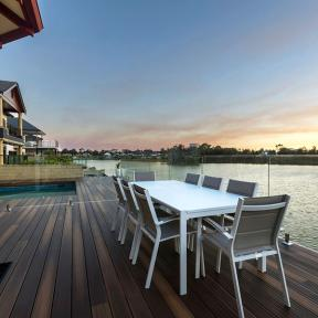 Blend your backyard and deck with lasting earth tones of DuraLife Siesta Grooved Edge Deck Boards in Mahogany.