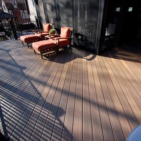 Let your deck be as relaxing as you feel with low-maintenance DuraLife Siesta Grooved Edge Deck Boards, shown in Tropical Walnut.