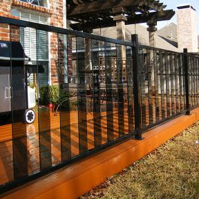 Fortress Pure View Glass Railing system in Gloss Black with Glass Balusters in Smoke.