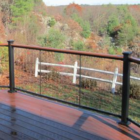 With a virtually invisible infill, the Fortress Vertical Cable Railing system helps your back yard shine.