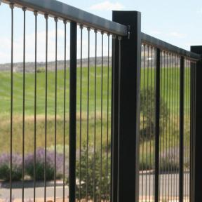 Arriving securely attached at both the top and bottom rails, the Fortress Vertical Cable Railing requires minimal assembly.